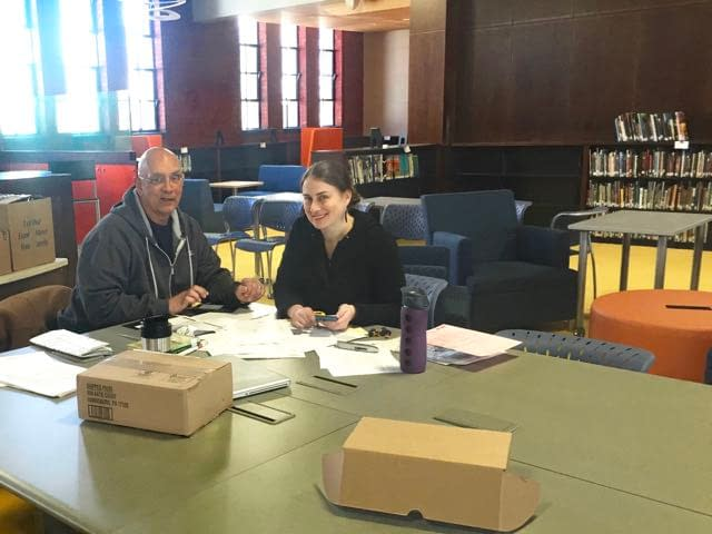 Library Director Emily Chameides and Board President David Murphy rounding up some details