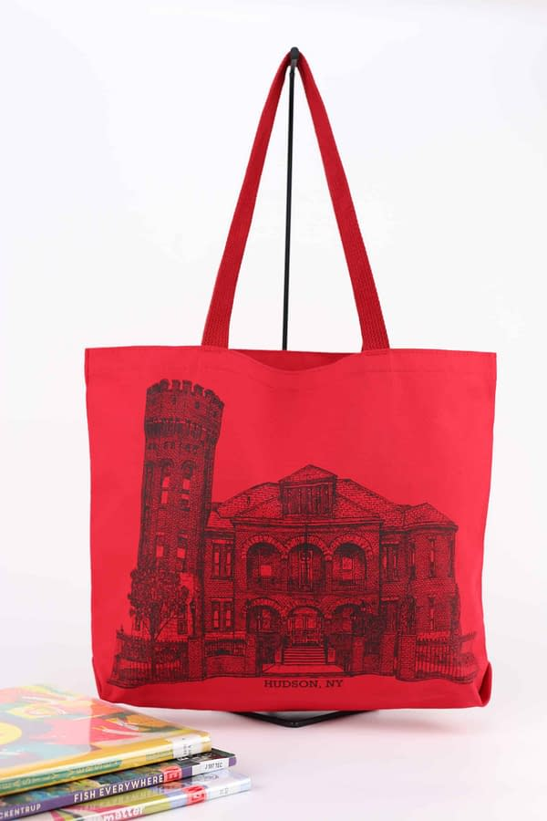 Red tote bag featuring line drawing by Tony Kieraldo of the historic Hudson Armory, home of the Hudson Area Library