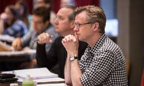 There is more to a Broadway musical than just songs and dances. It's the story that drives the production. Here, writer Brian Hill reviews a rehearsal. Photo courtesy of the Goodman Theatre.